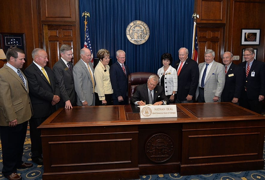 Commissioner Russell McMurry and members of the State Transportation Board join Governor Nathan Deal as he signs the GDOT Centennial Proclamation.